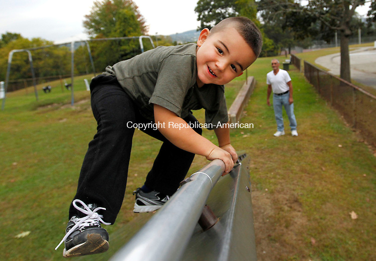 Waterbury, CT-26 September 2012-092612CM05- Joseph Bernacchi, 4, of Waterbury makes his way to the top of a climbing slide Wednesday afternoon at Chase Park jn Waterbury.  Proudly looking on is his grandfather, Carl Bernacchi.  The pair were out enjoying the day at the park by getting some exercise said Carl Bernacchi.  According to the National Weather Service, Thursday  could see some showers before 11am, otherwise it will be partly sunny, with a high near 69.    Christopher Massa Republican-American
