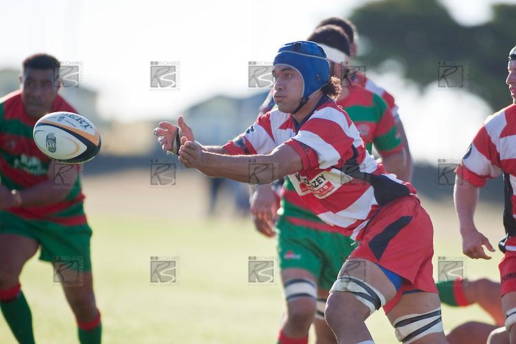 Osaiasi Koloamatangi gets the pass away from a ruck. Counties Manukau Premier Club Rugby game bewtween Waiuk & Karaka played at Waiuku on Saturday April 11th, 2010..Karaka won the game 24 - 22 after leading 21 - 9 at halftime.