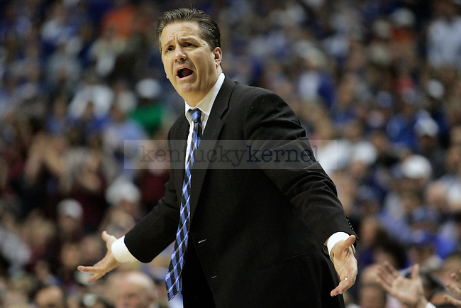 UK men's basketball coach John Calipari yells at his team in the second half of UK's win 75-74 over Mississippi State  Bridgestone Arena in the SEC Finals on Sunday, March 14, 2010. Photo by Britney McIntosh | Staff