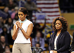 Oprah Winfrey and Michelle  Obama takes the stage during a rally for Democratic presidential candidate US Senator Barack  Obama at UCLA's Pauley Pavilion in Los Angeles, California, February 3, 2008. Fitzroy Barrett