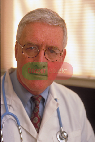 portrait of serious doctor with stethoscope