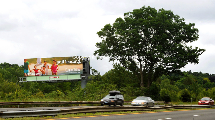 WATERBURY,  CT, 06 JUNE  2012-061212JS07--Motorists on I-84 in Waterbury drive past one of the new CTvisit.com billboards promoting state tourism. .Jim Shannon Republican-American