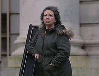 "Pictured: Jean Wilson stands outside Cardiff Crown Court. Wednesday 06 December 2017<br /> Re: Managing director Jean Wilson who stole £50,000 from the recruitment company she worked for to pay for a gastric band operation and a luxury £10,000 holiday, is due to be sentenced today at Cardiff Crown Court.<br /> Wilson, who lived in a rented mansion, also blew cash on paying for vets' bills, dog sitters, and dog groomers in a ""sophisticated"" scam.<br /> The 58-year-old appeared at Cardiff Crown Court on Tuesday after she had previously pleaded guilty to fraud by abuse of position.<br /> The defendant had held the position of managing director at Axcis Education Recruitment, now known as RO Education Ltd, for five years before her embezzlement was discovered and had spent 10 years at the company in total."