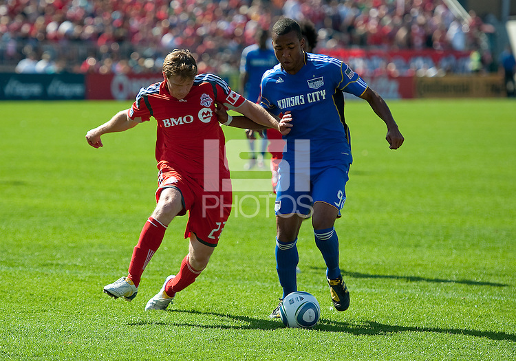 05 June 2010: Kansas City Wizards forward Teal Bunbury #9 battles with Toronto FC midfielder Jacob Petersen #23 during a game between the Kansas City Wizards and Toronto FC at BMO Field in Toronto..The game ended in a 0-0 draw.