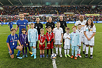 Referee Jonathan Moss with assistants, Gary Cahill of Chelsea (L), Andre Ayew of Swansea City and children mascots during the Premier League game between Swansea City v Chelsea at the Liberty Stadium, Swansea, Wales, UK. Saturday 28 April 2018