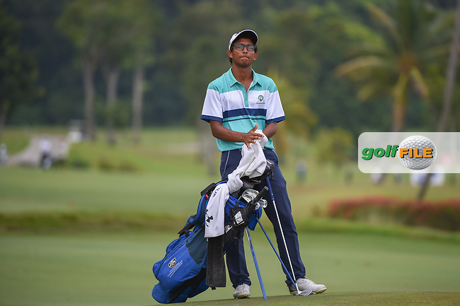 Kartik SHARMA (IND) looks over his chip shot for his first shot following a weather delay during Rd 3 of the Asia-Pacific Amateur Championship, Sentosa Golf Club, Singapore. 10/6/2018.<br /> Picture: Golffile | Ken Murray<br /> <br /> <br /> All photo usage must carry mandatory copyright credit (© Golffile | Ken Murray)