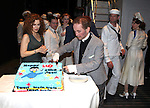 """Bernadette Peters surprises Joel Grey on his 80th birthday with a cake backstage at """"Anything Goes"""" at the Stephen Sondheim Theatre in New York City on April 11, 2012 © Walter McBride / WM Photography  Ltd."""