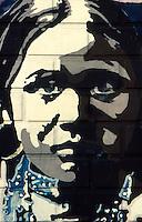 Milano 1977.Murales realizzati in via Negroli da un gruppo di giovani della sinistra alternativa su temi di carattere sociale. .Foto Livio Senigalliesi