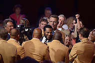 Canton, Ohio - August 6, 2015: Former NFL player Jerome Bettis greets current Hall of Famers as he is introduced before donning his dons his gold jacket for the first time during the 2015 Pro Football Hall of Fame enshrinement dinner in Canton, Ohio August 6, 2015. With eight 1,000 plus yard seasons, Bettis was tied for third-best in NFL history and his 13,662 career rushing yards ranked him fifth all-time. (Photo by Don Baxter/Media Images International)