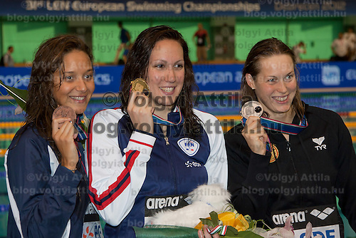 Bronze medalist Duane A Rocha Marce (L) of Spain, gold medalist Alexianne Castel (C) of France and Jenny Mensing (R) of Germany celebrate their victory in the Women's 200m Backstroke final of the 31th European Swimming Championships in Debrecen, Hungary on May 22, 2012. ATTILA VOLGYI