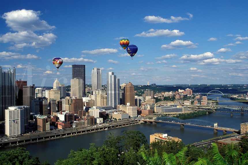 Pittsburgh, skyline, hot-air balloon, PA, Pennsylvania, Hot-air balloons from Three Rivers Regatta Festival hover over the downtown skyline of Pittsburgh along the Monongahela River.