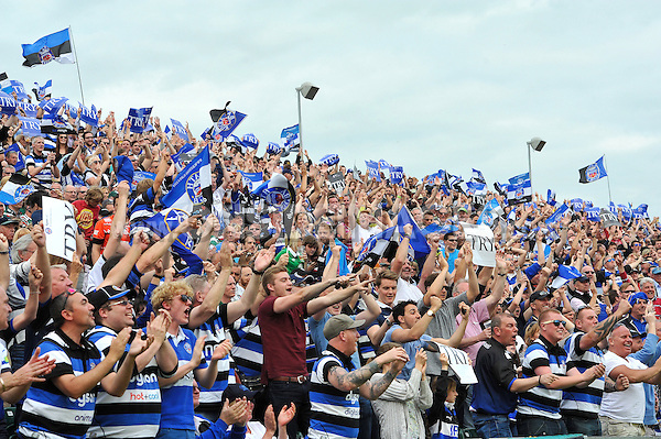 Bath supporters in the crowd celebrate a try. Aviva Premiership semi-final, between Bath Rugby and Leicester Tigers on May 23, 2015 at the Recreation Ground in Bath, England. Photo by: Patrick Khachfe / Onside Images