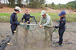 Sean Van Sommeran & Earthwatch Team Tying Nets Together
