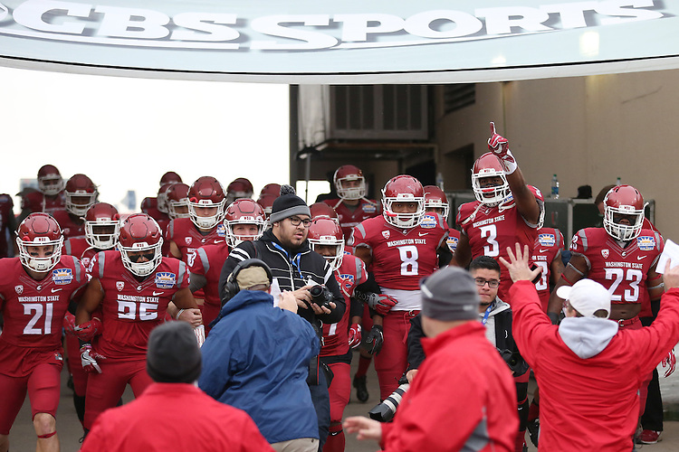 River Cracraft (21), Hunter Dale (35), Tyler Hilinski (3), Marcellus Pippens (27), Jeremiah Allison (8), Ivan Mclennan (3) and Gerard Wicks (23 lead the Cougs out of the locker room on to the field prior to their Hyundai Sun Bowl game against the Miami Hurricanes in El Paso, Texas, on December 26, 2015.  In a game that could have been named the Snow Bowl instead of the Sun Bowl, WSU took a 20-7 lead in to halftime and then held off a Miami fourth quarter rally to win their first bowl game since the 2003 Holiday Bowl, 20-14.