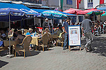 Tourists sit at cafes, Place Moulay Hassan, Essaouira, Morocco