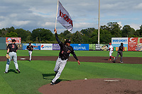 Batavia Muckdogs Ronal Reynoso (2) runs with the team flag after clinching the Pinckney Division Title during a NY-Penn League game against the Auburn Doubledays on September 2, 2019 at Falcon Park in Auburn, New York.  Batavia defeated Auburn 7-0 to clinch the Pinckney Division Title.  (Mike Janes/Four Seam Images)