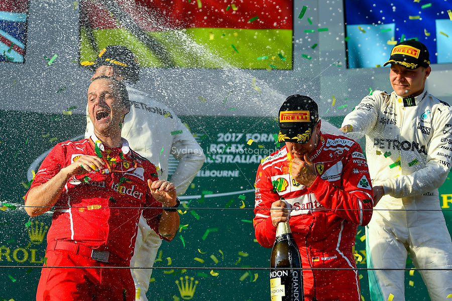 March 26, 2017: Luigi Fraboni and Sebastian Vettel (DEU) #5 from the Scuderia Ferrari team celebrate their win at the 2017 Australian Formula One Grand Prix at Albert Park, Melbourne, Australia. Photo Sydney Low