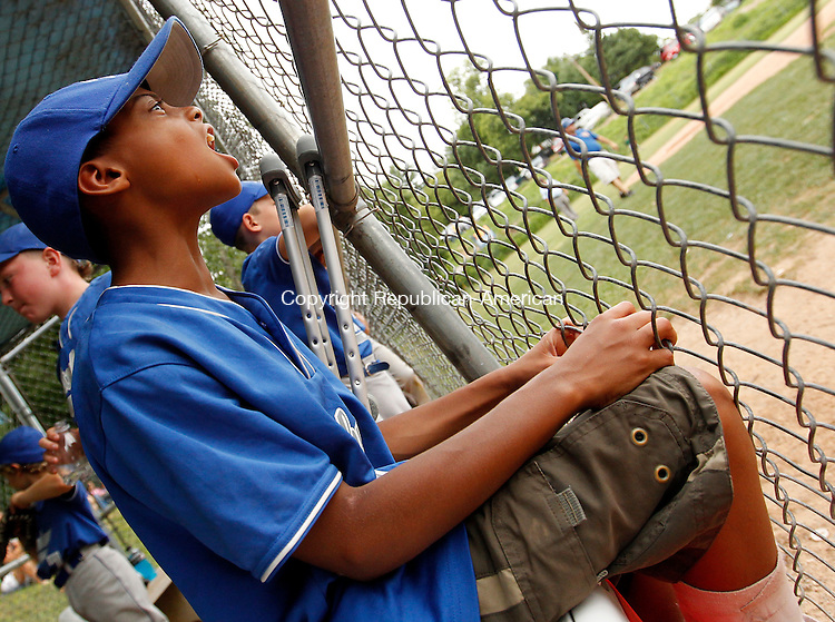 Waterbury, CT-12, July 2010-071210CM06  PAL's Bryant Bonilla cheers on teammates from the bench after breaking his ankle during a play in their previous game.  The Roberto Clemente 7-8 year old State Championship game was held Monday afternoon at the Wolcott BAW Complex.  Overlook won 12-3, after the game was called during the 5th inning, due to the Mercy Rule.     --Christopher Massa Republican-American