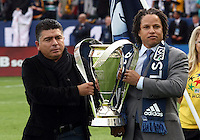 CARSON, CA - DECEMBER 01, 2012:  Ex players of the Los Angeles Galaxy Mauricio Cienfuegos and Cobi Jones bring in the trophy before the 2012 MLS Cup at the Home Depot Center, in Carson, California on December 01, 2012. The Galaxy won 3-1.