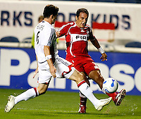 New England defender Jay Heaps (6) attempts to block a cross by Chicago Fire midfielder Cuauhtemoc Blanco (10). The Chicago Fire defeated the New England Revolution 2-1 at Toyota Park in Bridgeview, IL on October 6, 2007.