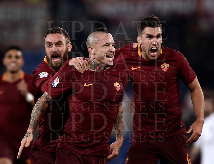 Calcio, Serie A: Roma vs Milan. Roma, stadio Olimpico, 12 dicembre 2016.<br /> Roma's Radja Nainggolan, center, celebrates  with teammates Daniele De Rossi, left, and Kevin Strootman, after scoring during the Italian Serie A football match between Roma and AC Milan at Rome's Olympic stadium, 12 December 2016.<br /> UPDATE IMAGES PRESS/Isabella Bonotto