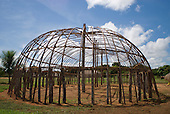 Xingu Indigenous Park, Mato Grosso State, Brazil. Aldeia Yawalapiti. Traditional oca house under construction; framework complete.