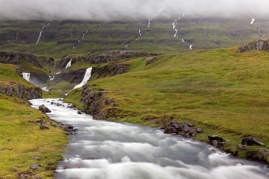 Vestdalsa River cascading through canyon over Vestdalsfossar Falls, East Iceland, Iceland