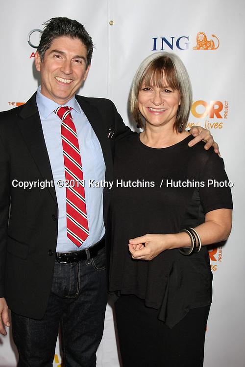 "LOS ANGELES - DEC 4:  James Lecesne, Peggy Rajski arrives at ""The Trevor Project's 2011 Trevor Live!"" at Hollywood Palladium on December 4, 2011 in Los Angeles, CA"