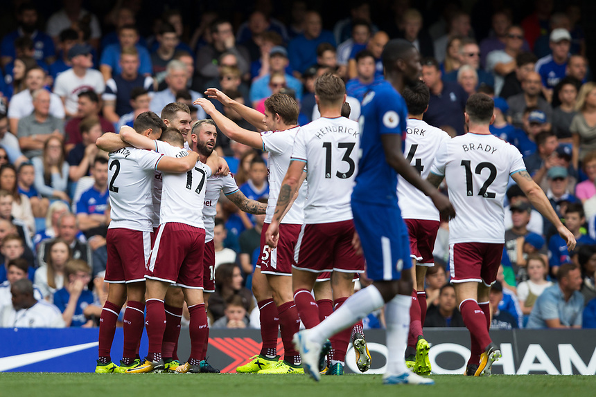 Burnley's Sam Vokes celebrates scoring the opening goal with team mates<br /> <br /> Photographer Craig Mercer/CameraSport<br /> <br /> The Premier League - Chelsea v Burnley - Saturday August 12th 2017 - Stamford Bridge - London<br /> <br /> World Copyright &copy; 2017 CameraSport. All rights reserved. 43 Linden Ave. Countesthorpe. Leicester. England. LE8 5PG - Tel: +44 (0) 116 277 4147 - admin@camerasport.com - www.camerasport.com