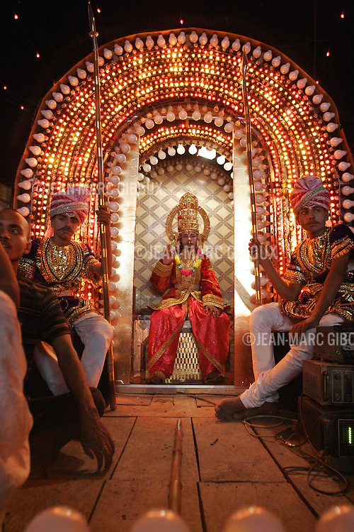 """.VARANASSI, UTTAR PRADESH, INDIA - October 8, 2005 : A """"disco lila"""", a modern version of the Ramlila is going down the streets in a parade of tableaux depicting the epic of the Ramayana in Varanassi . Varanassi, also named Benares or Kachi, is one of the holiest place for Hindus in India, drawing millions of pilgrims every year. They come to prey to along the temples lining the ghats, and purify themselves in the """"Holi Ganga"""". It always has been an auspicious place to die, since expiring here offers 'moksha', liberation of the circle of life and death. (Photo by Jean-Marc Giboux/Getty Images)"""