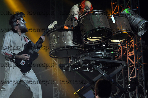 Slipknot - gutiarist Jim Root (#4) and Shawn 'Clown' Crahan (#6) - performing live on day One on the Main Stage at Download Festival Donington Park UK - 14 June 2013.  Photo credit: Graham Finney/Music Pics Ltd/IconicPix