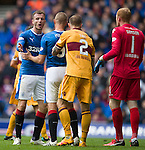 Andy Halliday and Kenny Miller having an exchange of words in the penalty box