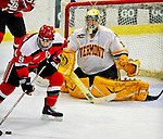 3 January 2009: University of Vermont Catamount goaltender Rob Madore, a Freshman from Venetia, PA, keeps St. Lawrence Saints' forward Kevin DeVergilio from scoring in the third period during the championship game of the Catamount Cup Ice Hockey Tournament hosted by UVM at Gutterson Fieldhouse in Burlington, Vermont. Madore recorded his first college career shut out against the Saints, leading the Cats to a 4-0 win and taking the tournament for the second time since its inception in 2005...Mandatory Photo Credit: Ed Wolfstein Photo