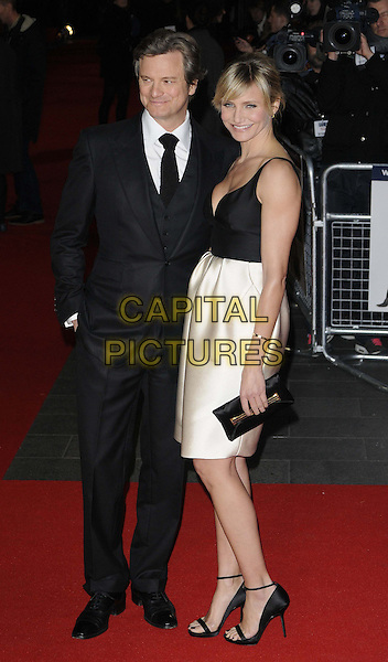 Colin Firth & Cameron Diaz.'Gambit' world film premiere Empire cinema, Leicester Square, London, England..7th November 2012.full length top silk satin white skirt clutch bag open to ankle strap sandals black low cut neckline cleavage clutch bag  suit shirt tie hand in pocket.CAP/CAN.©Can Nguyen/Capital Pictures.