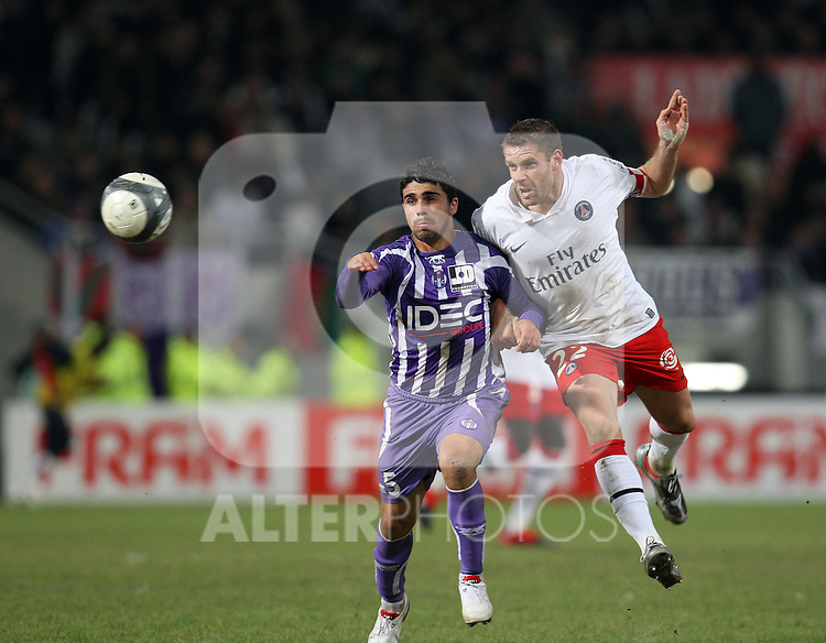 Sylvain Armand challenges Machado as Toulouse beat Paris Saint Germain 1-0 at Stade Municipal, Toulouse, France, 18th October 2009.