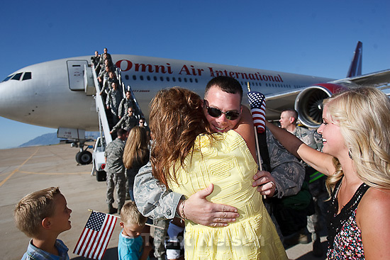 Trent Nelson  |  The Salt Lake Tribune.Tech Sergeant Steve Lyskowski is welcomed home by his wife Amy and their children as the 729th Air Control Squadron returned to Hill Air Force Base in Layton, Utah, after six months in Afghanistan Wednesday, July 20, 2011.