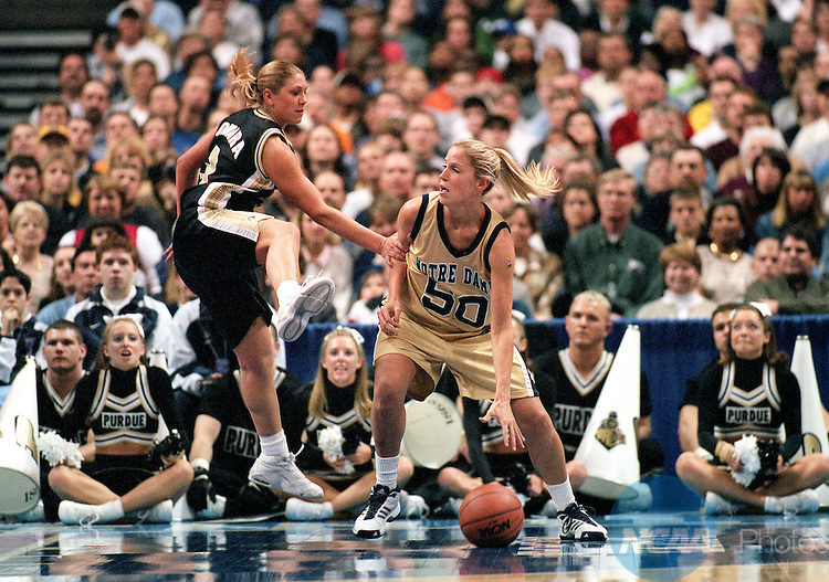 01 APR 2001:  Forward Kelley Siemon (50) of Notre Dame makes a move on guard Kelly Komara (3) of Purdue during the Division 1 Women's Basketball Championships held at the Savvis Center in St. Louis, MO.  Notre Dame defeated Purdue 68-66 for the national championship title.  Jamie Schwaberow/NCAA Photos