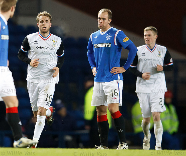 Andrew Shinnie celebrates his goal as Steven Whittaker is dejected