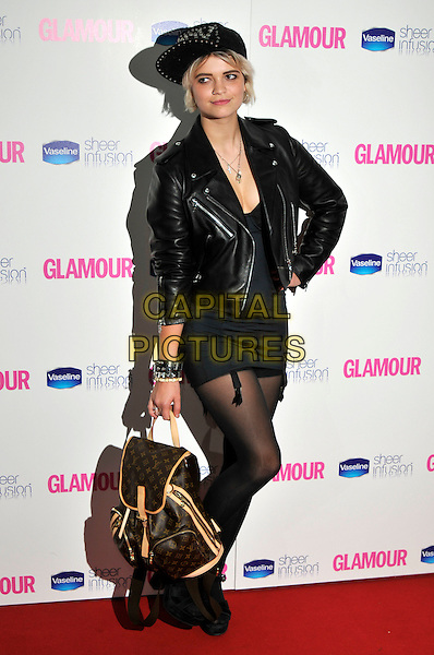PIXIE GELDOF .Glamour Women Of The Year Awards - Inside Arrivals, Berkeley Square Gardens, London, England, UK, .June 8th 2010..full length suspenders dress underwear bodice basque tights Louis Vuitton logo backpack rucksack bag hand on hip head cap hat leather jacket studs studded.CAP/PL.©Phil Loftus/Capital Pictures.