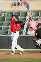 Nick Basto (14) of the Kannapolis Intimidators follows through on his swing against the Delmarva Shorebirds at CMC-Northeast Stadium on June 7, 2015 in Kannapolis, North Carolina.  The Shorebirds defeated the Intimidators 9-1.  (Brian Westerholt/Four Seam Images)