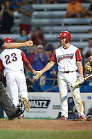 Williamsport Crosscutters outfielder Aaron Brown (33) congratulates Jiandido Tromp (23) after a home run during a game against the Aberdeen IronBirds on August 4, 2014 at Bowman Field in Williamsport, Pennsylvania.  Aberdeen defeated Williamsport 6-3.  (Mike Janes/Four Seam Images)