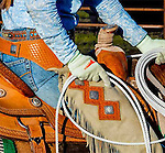 Closeup of a cowgirl chaps, saddle and rope. Escuela Ranch, San Luis Obispo, California