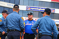 Jun 5, 2015; Englishtown, NJ, USA; NHRA sponsor rep Don Corsette talks with members of the New Jersey State Police during qualifying for the Summernationals at Old Bridge Township Raceway Park. Mandatory Credit: Mark J. Rebilas-