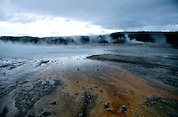 GEYSERS<br /> Black Sand Basin - Yellowstone National Park<br /> Upper geyser basin.  An underground chamber of water is heated to boiling by molten rock.  The pressure forces a superheated column of steam &amp; water to the surface.  The column of water vaporizes, erupting out of the ground.