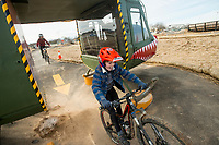 NWA Democrat-Gazette/BEN GOFF @NWABENGOFF<br /> Treyton Wells, 8, of Bella Vista rides through the helicopter feature on the skills lines Saturday, Feb. 9, 2019, at the Runway Bike Park at the Jones Center in Springdale. The bike playground and pump track at the park opened in late September, but the skills lines were delayed in opening until today due to weather and drainage issues.