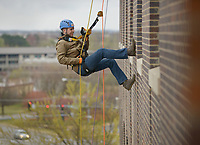 NWA Democrat-Gazette/BEN GOFF @NWABENGOFF<br /> Guests rappel Saturday, March 11, 2017, during the Sunshine School &amp; Development Center's rappelling fundraiser with Over The Edge at the 8W Center in Bentonville. The school began a campaign in January, with participants who reached their fundraising goal able to participate in rappelling from the roof of the 6-story building. Over the Edge is a company which specializes in producing events for non profits using equipment and techniques used in commercial rope-access work such as sign installation and window washing. The event had raised more than $57,000 for the school, with more donations still coming in Saturday morning. Located in Rogers, the Sunshine School &amp; Development Center serves children and adults with developmental dissabilities, including a preschool.