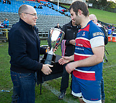 Andrew Toop from Counties Power presents Ardmore Marist Captain Christian Kelleher with the Counties Power Cup for winning the regular season. Counties Manukau Premier 1 McNamara Cup Final between Ardmore Marist and Bombay, played at Navigation Homes Stadium on Saturday July 20th 2019.<br />  Bombay won the McNamara Cup for the 5th time in 6 years, 33 - 18 after leading 14 - 10 at halftime.<br /> Photo by Richard Spranger.