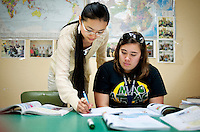 "Yue Zheng, (cq) a Chinese english teacher who has been teaching at Macarthur High School, works with senior Cynthia Thompson (cq) during a Chinese 2 class in Lawton, Oklahoma, April 29, 2010.  Zheng is teaching in the US as part of a ""guest teacher"" program for two years...PHOTO/ MATT NAGER"