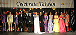 Taiwan born fashion designer, Malan Breton poses with models for the close of his Spring 2015 collection fashion show, for the Celebrate Taiwan event in Grand Central Terminal on September 27, 2014.