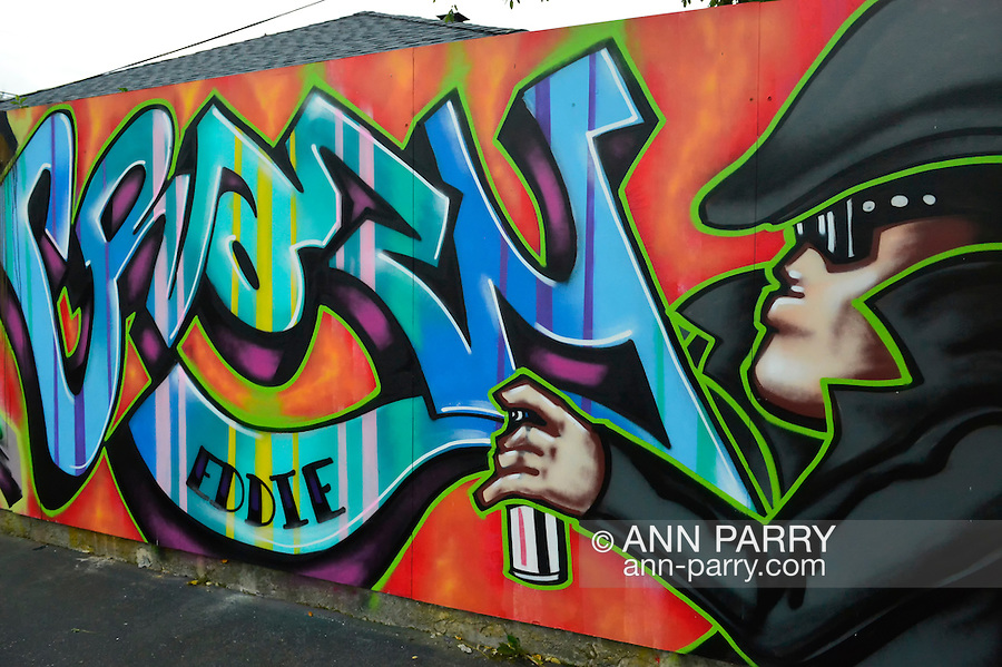 Massapequa, New York, USA. September 18, 2014. Outdoor Art Wallgraffiti by Crazy Eddie is on view at the Studio 5404 Art Space opening reception for art show Taking it to the Street, which exhibited new works by emerging and up-and-coming local and New York artists. Studio 5404 is on the South Shore of Long Island.